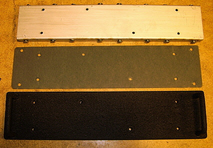 photo top: The three pieces that make up the coil panel. The handles are already mounted and the panel painted with VHT Black Wrinkle Finish paint.